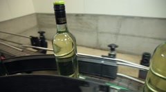 Wine bottles in conveyor belt  bottling line industry Stock Footage