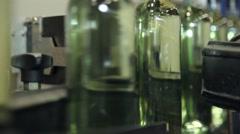 Wine bottles in conveyor belt  bottling line industry, slider shot Stock Footage