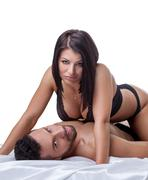 Erotica. Image of hot brunette lies on bearded man Stock Photos