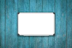 Blank white board on blue wooden texture background - stock illustration