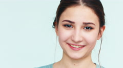 Close-up portrait girl teenager 14 years old sneezes and smiling at camera Stock Footage