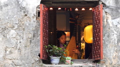 Girl play Kunqu with Chinese tradition Pipa beside window Stock Footage