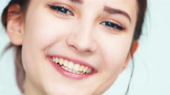 Extreme closeup portrait face girl 14 years old teenager on white Stock Footage