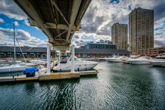 Bridge over a marina and buildings at the Harbourfront, in Toronto, Ontario. Stock Photos