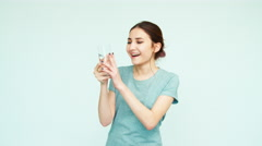 Portrait cheerful girl teenage 14 years joy are very happy glass of water Stock Footage