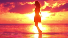 happy young woman whirling at the beach on sunset in slow motion - stock footage