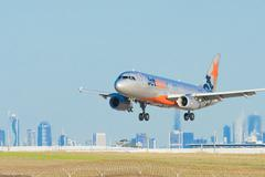 Jetstar airplane landing at Melbourne Airport Stock Photos