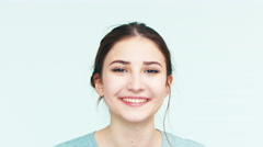 Portrait girl 14 years old teenager on the white background. Teen laughing Stock Footage