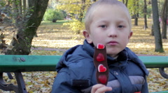 Autumn eating chocolate candy Stock Footage