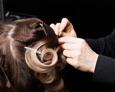 Master stylist makes the bride wedding styling. beautiful satisfied client in Stock Photos