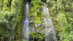 Tilt down a waterfall running down a rock face. Time-lapse, Ecuador Stock Footage