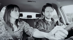 Woman in car holding hand of boyfriend starting to cry slow motion - stock footage