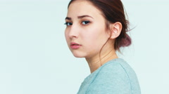 Resentment. Portrait cute girl 14 years old on white background Stock Footage