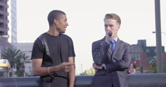 Mixed race friends talk and vape in Downtown Los Angeles 4K Stock Footage