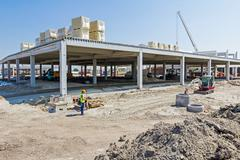 View on construction site, unfinished modern mega market. Architecture concep Stock Photos