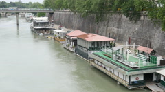 Water houses and pontoons on the river Tiber in Rome Italy Stock Footage