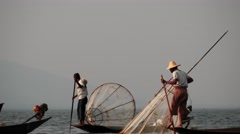 Fishers on boat in waters at Inle lake  in Myanmar short video Stock Footage