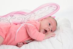 Close up of a newborn baby girl with angel wings Kuvituskuvat