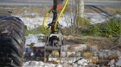 A log grapple getting logs from the ground Stock Footage