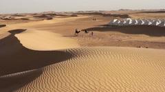 Camel ride near a bivouac in Sahara desert Stock Footage