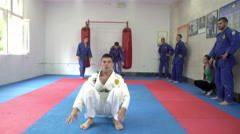 Sportsmen performing somersaults, real aikido by Pakito,crane shot, Stock Footage