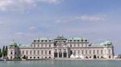 Beautiful Palace Belvedere Stands Against Blue Sky in Front of Pond, Time Stock Footage