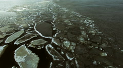 Breaking edge of ice cover with ice raft fragments in spring, aerial shot Stock Footage