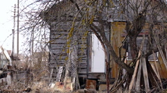 Abandoned very old little wooden house Stock Footage