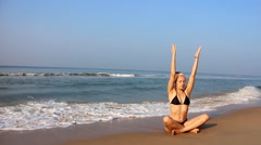Training yoga on the beach of the Indian ocean Stock Footage