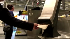 Woman taking napkin at food cafeteria inside Ikea store - stock footage