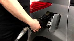 Man removing handle from car hole at Chevron gas station. Stock Footage