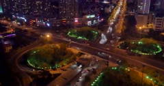 4k busy urban traffic on overpass at night,urban morden building,QingDao china. Stock Footage
