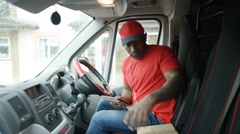 4K Portrait of smiling delivery driver checking packages inside his vehicle Stock Footage