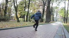 Boy run autumn Stock Footage