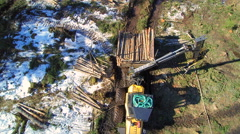 The aerial view of the forest harvester at work Stock Footage