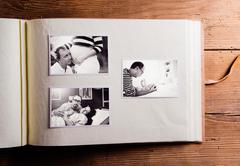 Fathers day composition. Photo album, black-and-white pictures - stock photo