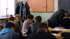 The group of students write the report on laboratory work in the classroom. - stock footage