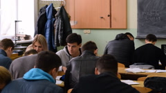 Group of students prepare for the exam in the classroom. - stock footage