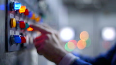 Man pressing a buttons on a industrial machine. Stock Footage