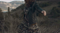 Lovely girl in a dress and leather jacket walking on the parapet Stock Footage