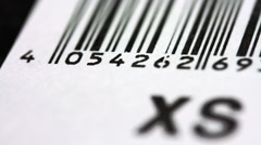 Pan Over A Bar Code From A Garment Price Tag Stock Footage