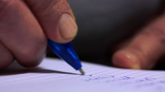 Macro Shot Of A Woman Hand Writing A shopping List Stock Footage