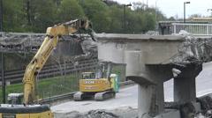 Demolition Machine Knocking Down a Bridge in Toronto Stock Footage
