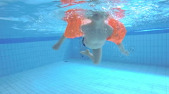 Child swims in the pool. Slow motion - stock footage