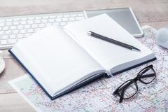 Diary notepad with accessories on table Stock Photos