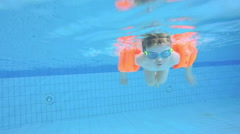 Child swims in the pool. Family travel. Slow motion Stock Footage