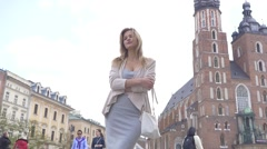 2 in 1. Young model having a photo session. Old town background. Slow motion - stock footage
