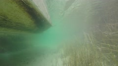 An underwater shot of a boat moving in shallow caribbean ocean Stock Footage
