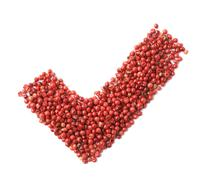 Yes tick mark made of pepper seeds Stock Photos