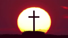 The cross on the background of sun. Time lapse - stock footage